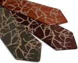 Silk Antler print neckties. Tan on champagne, dark brown, cinnamon.