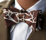 Tan ink on a brown bow tie.