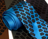Tire Tread Necktie. Black on electric blue.