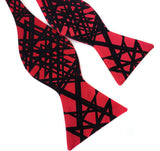 Black ink on red bow tie.