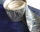 detail of cream sea waves necktie