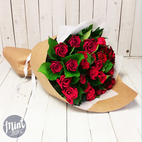 Two Dozen Premium NZ Red Roses - Beautifully Roll Wrapped