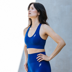 A Female Model Poses Wearing Hyperflex Seamless Leggings Electric Blue