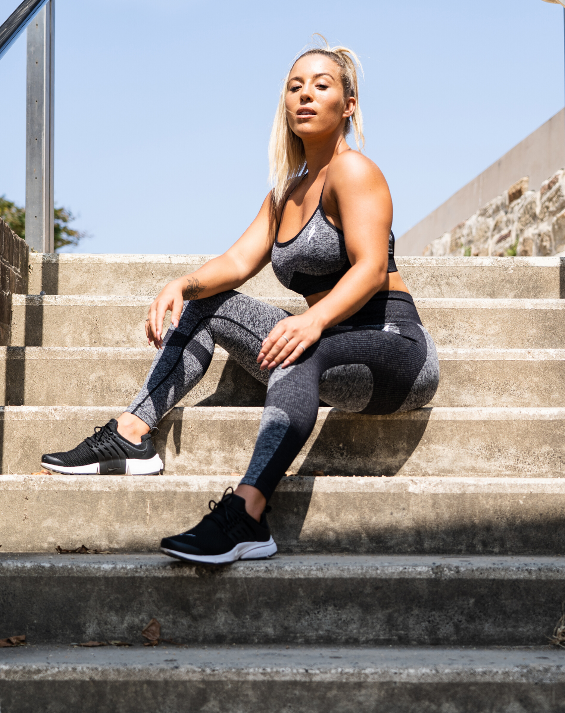 Kali Burns poses on stairs wearing Doyoueven Impact Seamless