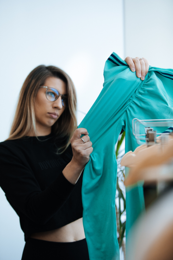 Fashion Designer Holds Sample Up To Examine - DYE Scrunch Seamless