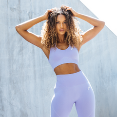 A Female Model Poses Wearing Hyperflex Seamless Leggings Lavender