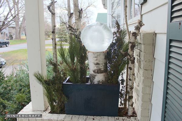 Fill in more greens into the Wintercraft Globe Ice Lantern Perch Front Entrance Planter
