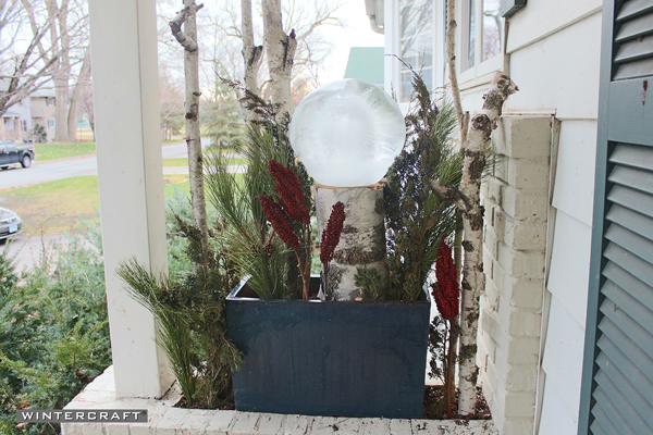 Add other hardwood decorations to the Wintercraft Globe Ice Lantern Perch Front Entrance Planter