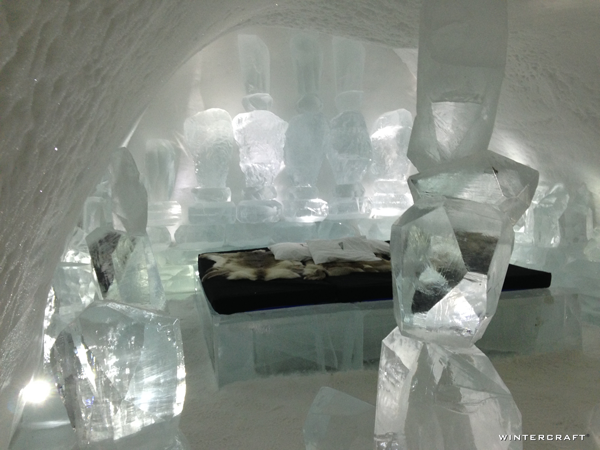 A room in the Ice Hotel filled with stacked ice chunks to resemble Cairns or Inuksuks.