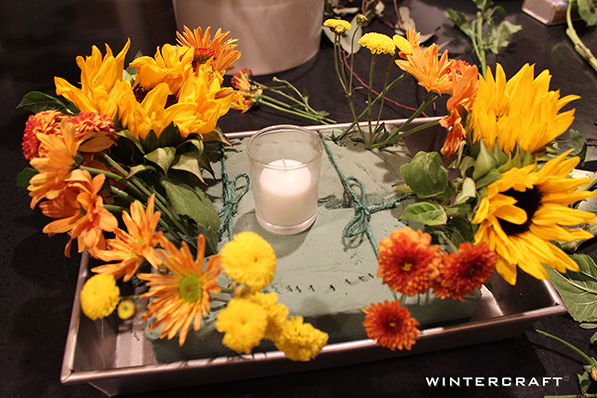 Add flowers to foam for centerpiece Wintercraft