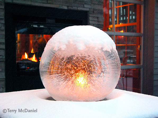 Candlelit Wintercraft Globe Ice Lantern - photo by Terry McDaniel