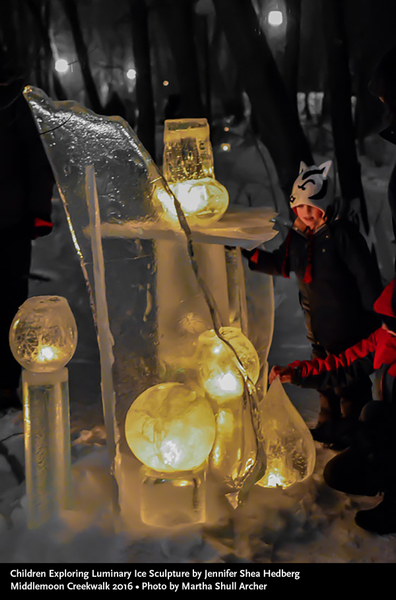 Children Exploring Luminary Ice Sculptures Middlemoon Creekwalk 2016 photo by Martha Shull Archer