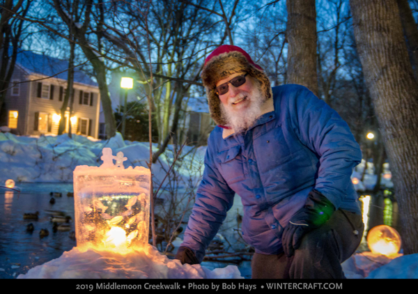 Dale Hammerschmidt posed by Mary Arneson's Ice People lantern 2019 Middlemoon Creekwalk Photo by Bob Hays Wintercraft
