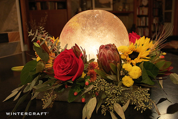 Simple Cake Pan Centerpiece using a Globe Ice Lantern and Grocery Store Flowers