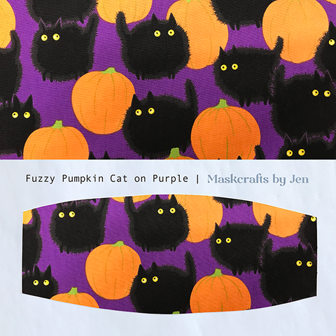 Fuzzy Pumpkin Cat on Purple