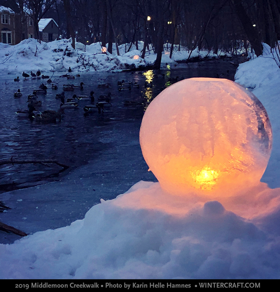 Globe ice lantern by creek w ducks 2019 Middlemoon Creekwalk photo by Karin Helle Hamnes