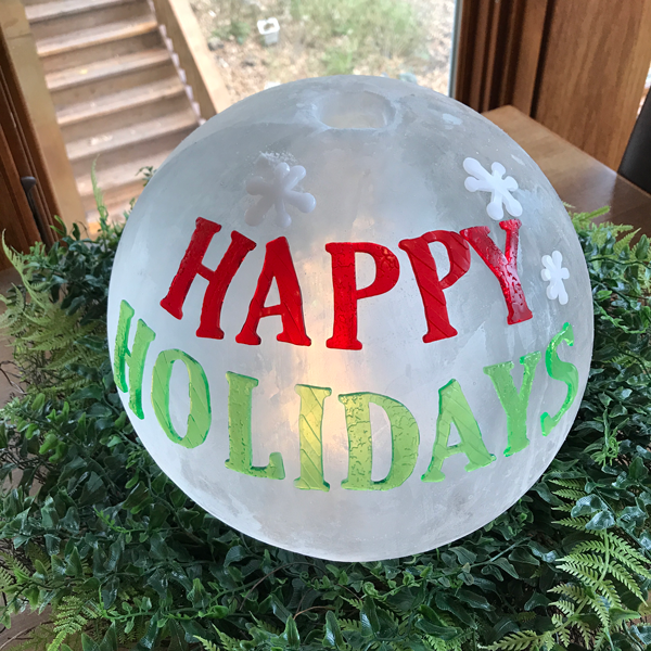 Happy Holidays message on frosted globe ice lantern Ice Wrangler Wintercraft