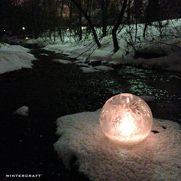 Wintercraft Middlemoon Creekwalk, spontaneous luminary lighting, solitary globe ice lantern lit on the sandbar