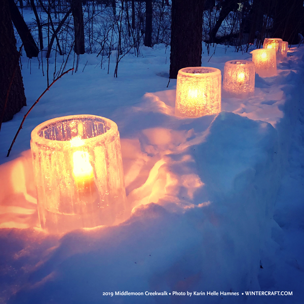 Textured bucket ice lanterns lined the walkway at 2019 Middlemoon Creekwalk ice by Mary Arneson photo by Karin Helle Hamnes