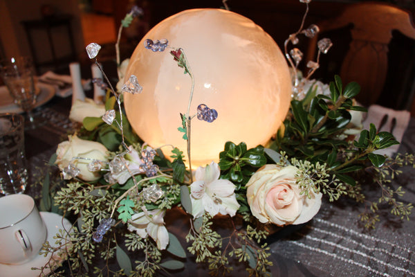 Wintercraft Photo Contest 2015 First Place Indoor goes to Michele Klein who created a beautiful Globe Ice Lantern Centerpiece surrounded by roses and sparkly bits!