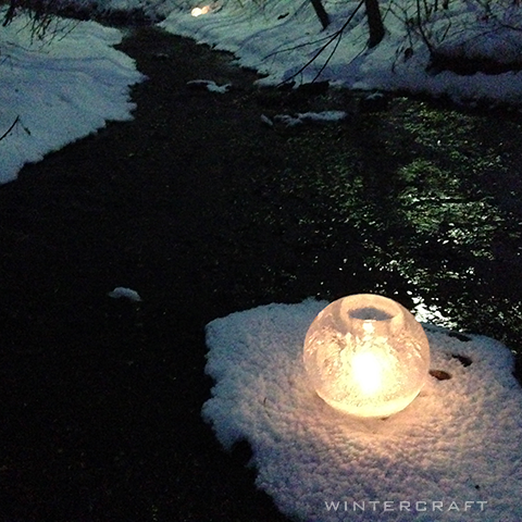 Wintercraft Romantic setting middlemoon creekwalk  globe ice lantern by creek