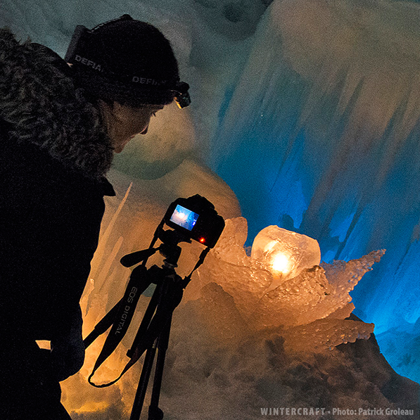 Jen taking picture of ice rose at New Hampshire Ice Castle