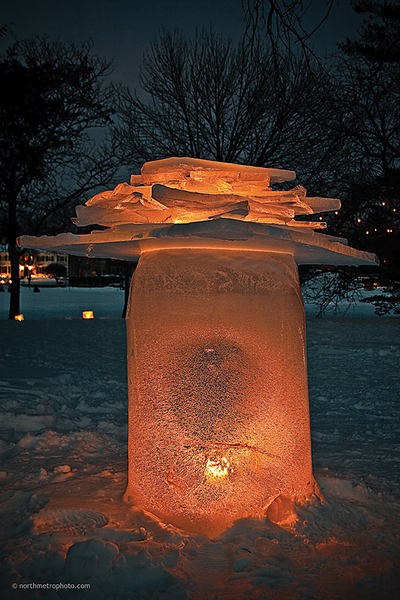 An ice mushroom at the 2010 Luminary Loppet in Minneapolis, MN. To establish scale, the lower area of the sculpture was created using a garbage can!