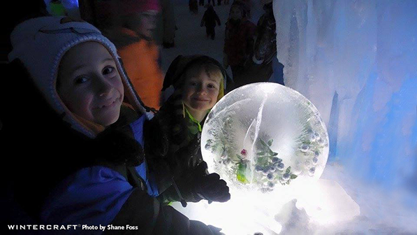 Anna frozen into a globe ice lantern delighted children at the Eden Prairie Ice Castles