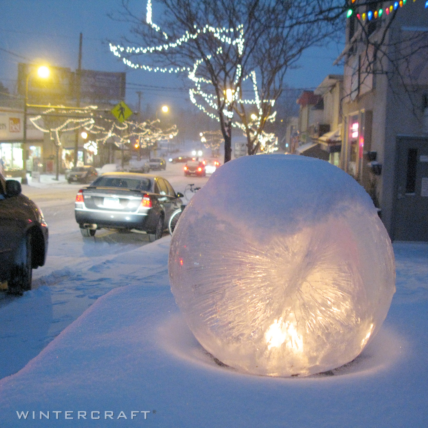 Wintercraft globe ice lantern beautifies a street for the holiday shopper