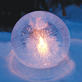 Stunning Globe Ice Lantern lit with Candlelight