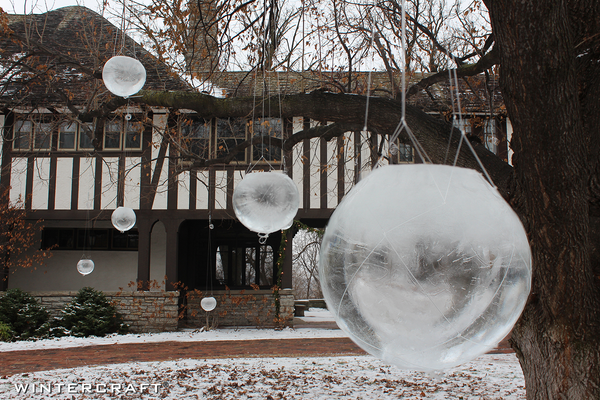 Globe Ice Lanterns hanging in a tree!