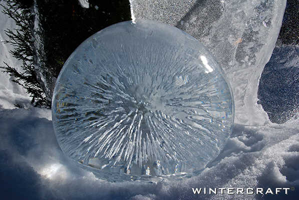 Wintercraft Globe Ice Lantern lit by sun