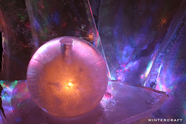 A close up of a ice globe and ice glass display at the entrance of the Bloomington REI store. I used lights to create a Northern Lights look.