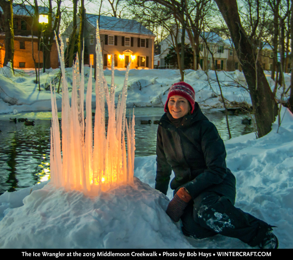 The Ice Wrangler, Jennifer Shea Hedberg posing next to an Icicle Castle at the 2019 Middlemoon Creekwalk