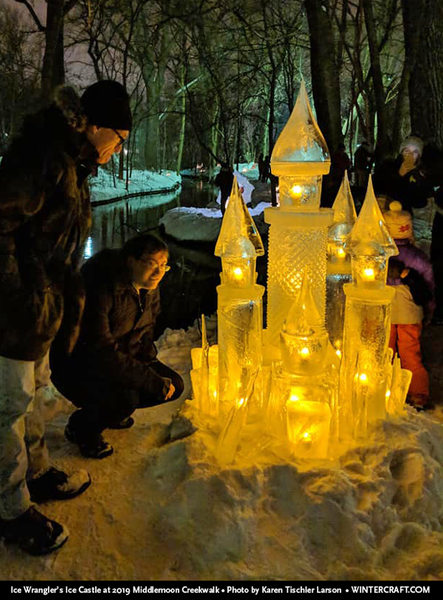 People looking at the 2019 ice castle by Jennifer Shea Hedberg Ice Wrangler Middlemoon Creekwalk photo by Karen Tischler Larson