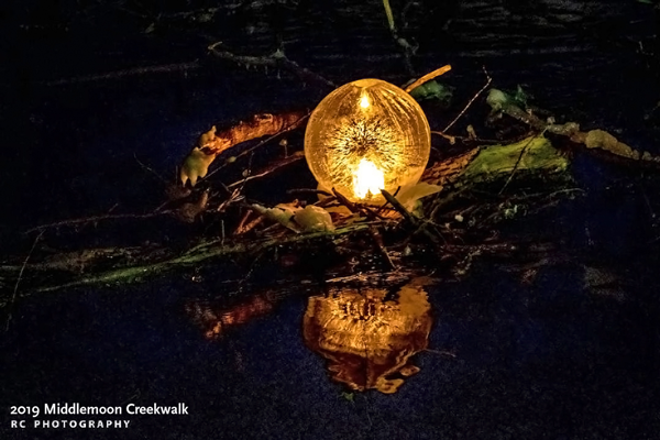 Globe ice lantern in the creek photo by Rick Chasin 2019 Middlemoon Creekwalk