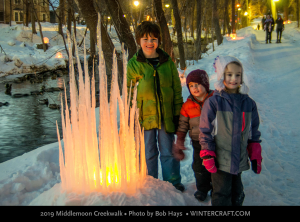 Kids near the Icicle Castle 2019 MIddlemoon Creekwalk Photo by Bob Hays Wintercraft