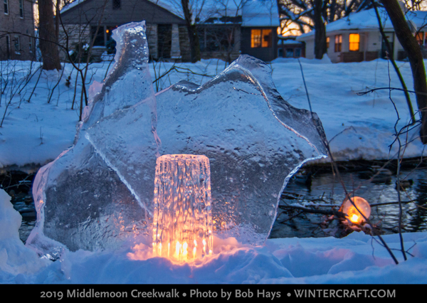 An old Finnish Glass Ice Tower still was pulled out of a snow bank and placed with some ice glass. Photo by Bob Hays 2019 Middlemoon Creekwalk Ice Wrangler