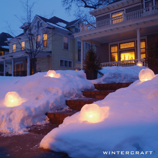 Decorate front entrance with Globe Ice Lanterns lit with candles