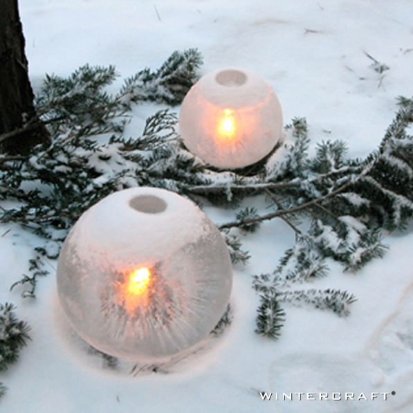 Snowfall adds a beautiful cap to candlelit Wintercraft Globe Ice Lanterns