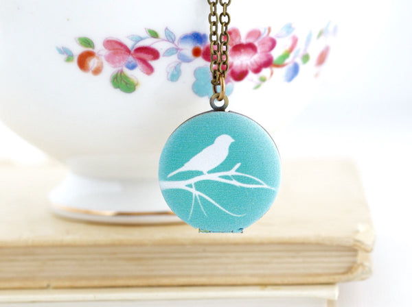 Turquoise and White Bird Silhouette Locket