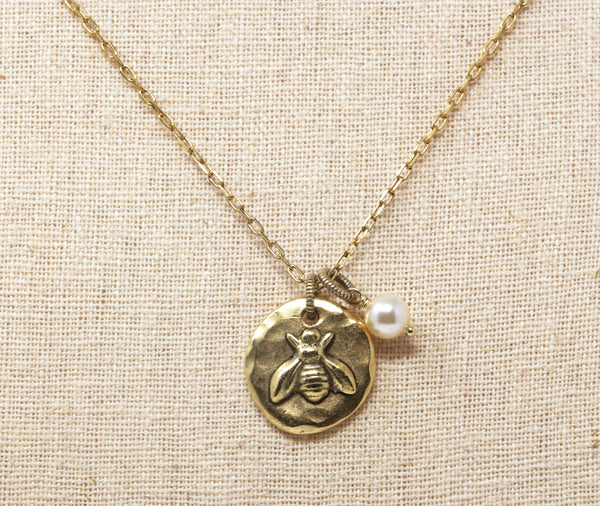 Circular Disk Golden Bee Pendant With Pale Gold Pearl Bead - Jacaranda