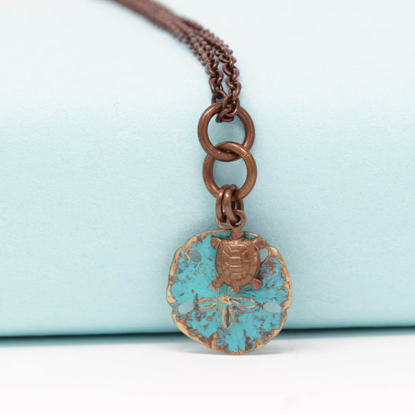 Small Patina Sand Dollar Necklace With Tiny Sea Turtle Charm - Jacaranda