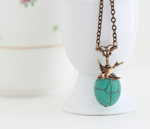 Turquoise Pendant With Brass Bird Charm - Jacaranda