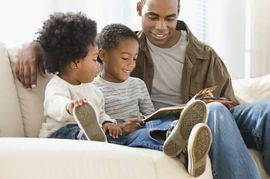 African American Father Reading to Children