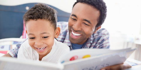 African American Father Reading to Son