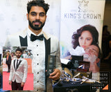 Celebrity posing with a Kings Crown Ultra rich Shave Cream in a Blue Box