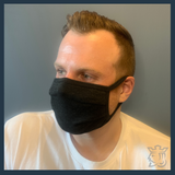 Man wearing Charcoal Grey Protective Mask made from bamboo cotton. Color Black.