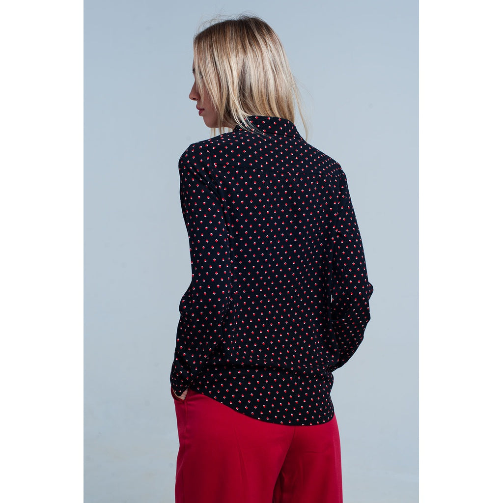 Black shirt with red polka dots