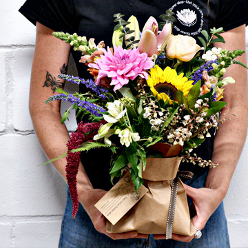 That little flower bag, Posy of flowers arranged in a mason jar, in a brown paper bag and tied with string